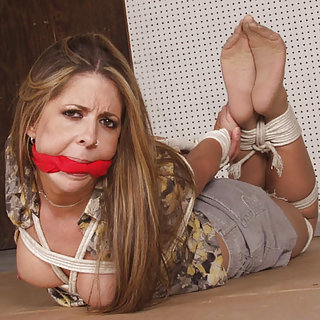 Pretty girl roped, cleave-gagged, exposed