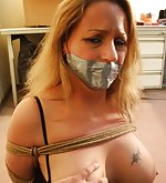 Roped, tape-gagged, struggling