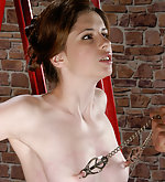 Cutie cuffed to the ladder, clamped and used