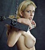 Cuffed, chained, stripped, hooked, dildoed