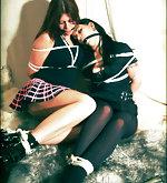 Two brunettes bound together