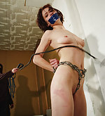 Chained and gagged, bullwhipped hard