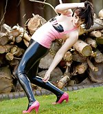 Brunette poses in pink and black latex