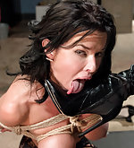 Brunette squirts in lesdom bondage sex