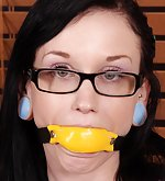Chained, cuffed, gagged with a big yellow gag