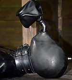 Leather bag, breath play, painful shocks