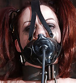 Locked, tightly gagged and forced to cum