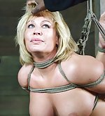 Blonde and bubbly milf gets roped and fucked