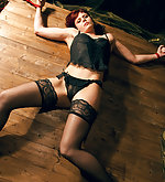 Sexy redhead in spread rope bondage