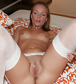 Alisson in white nylons spreads legs