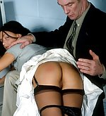 Brunette in stockings gets spanked