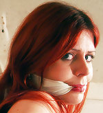 Superheroine is crucified and gagged