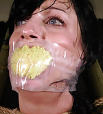 Roped, suspended, tight gagged, dildoed
