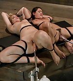 Two girls are bound together & machined