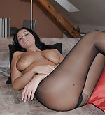 Christina poses in cut open pantyhose