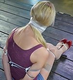 Blonde bondage slut zipped, cuffed, hooked