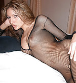 Shania in a crotchless net body stocking