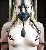 Put in stocks, cuffed, tits clasped, tightly gagged