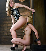 Hot blonde fucked in metal restraint