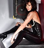 Brunette in shiny black latex and high heels