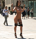 Shackled, stripped naked, caned in public