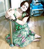 Pretty woman cuffed to the pole