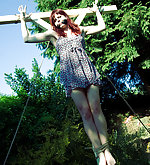 Redhead crucified and cleave-gagged