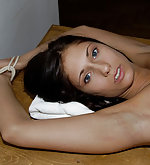 Pretty naked blonde tied to a table