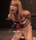 Sexy blonde bound and machine fucked