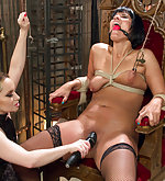 Latex slut gets tied and fisted in both holes