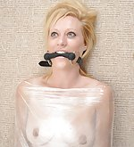 Wrapped, bit-gagged and forced to cum