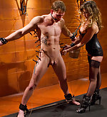 Leather clad dominatrix fucks muscular slaveboy