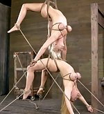 Two blonds roped, suspended, face fucked