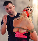 Bound, mouth-stuffed, tape-gagged